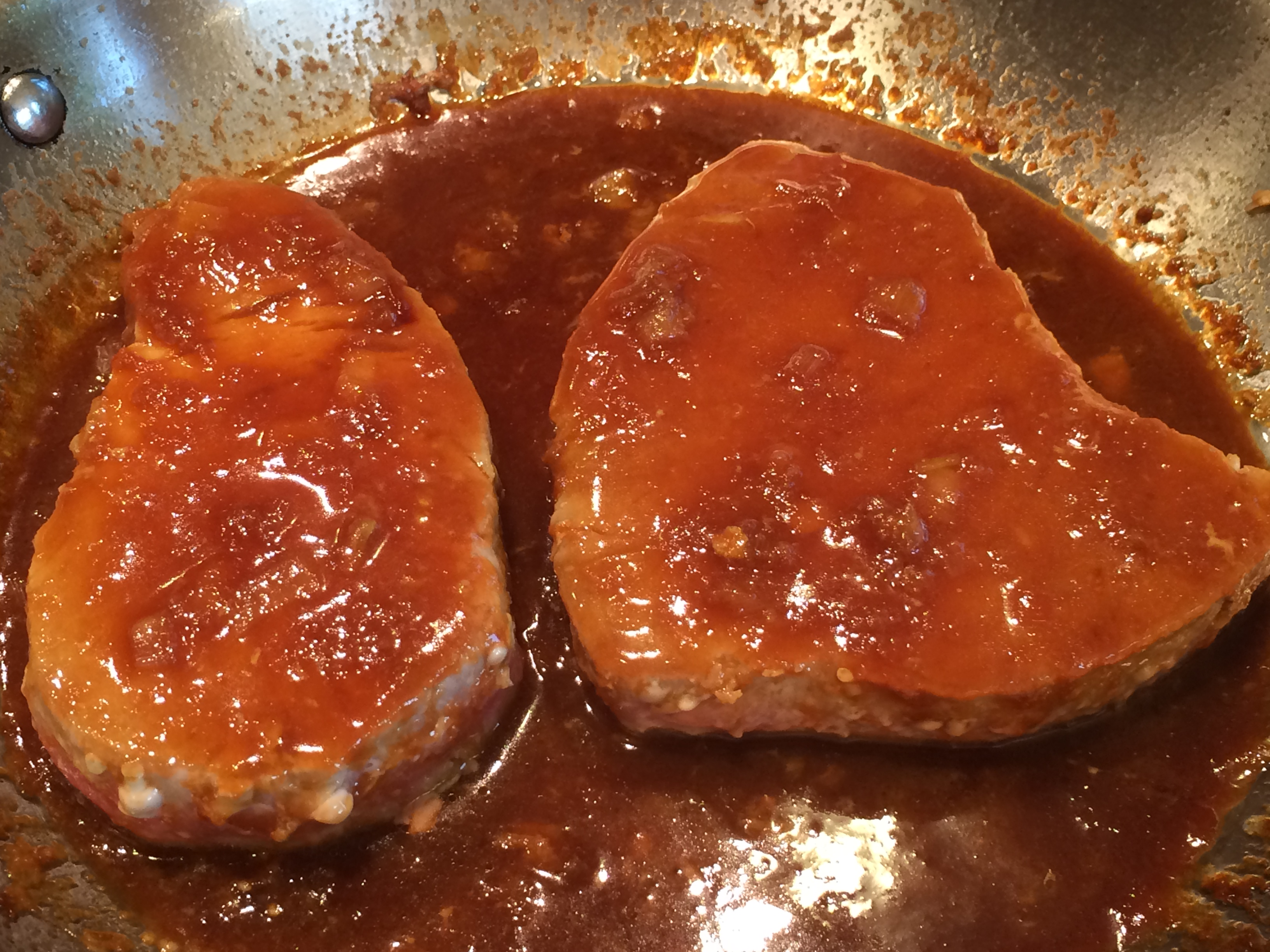 ... the sauce. Put tuna steaks back into the pan and cover with sauce